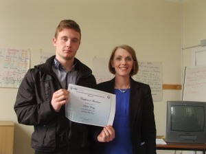 David receiving his certificate of attendance