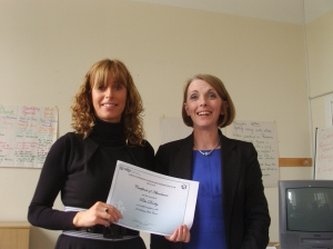Rita receiving her certificate of attendance