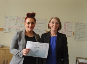 Orla receiving her certificate of attendance
