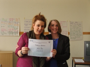 Shauna receiving her certificate of attendance